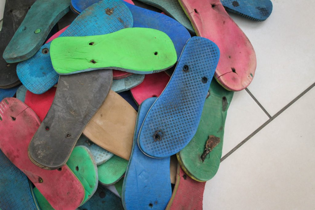 Discarded Flip Flop Pile Waste To Wonder