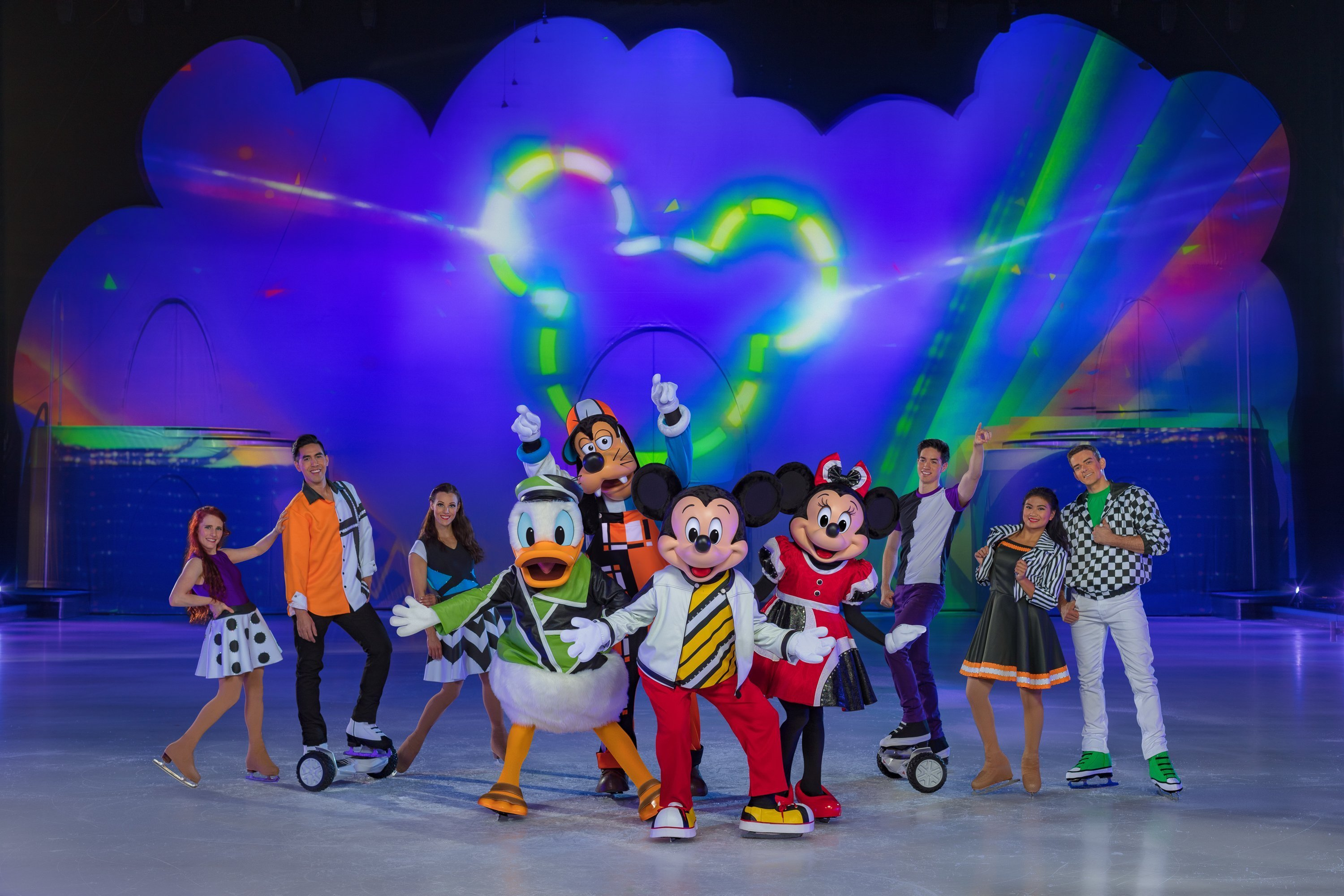 Mickey Disney On Ice Cast standing in front of Mickey Mouse light up stage