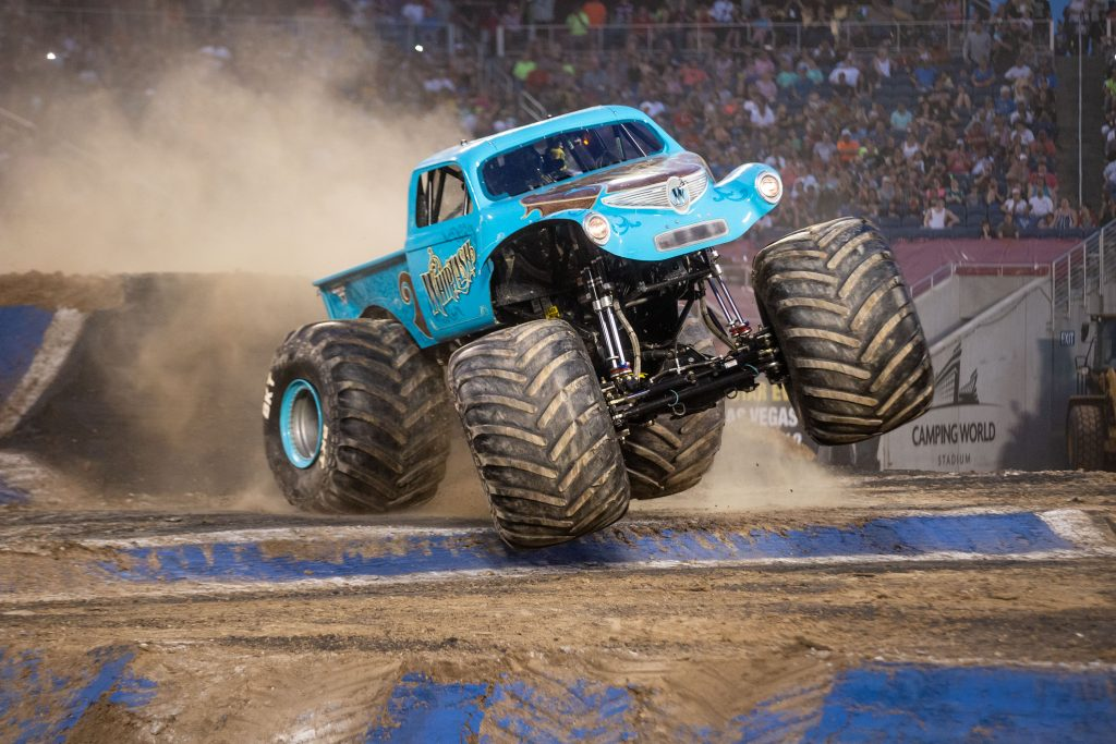 Monster Jam Whiplash truck going over ramp on ground