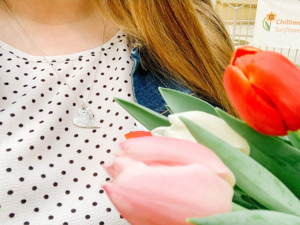 Tendertouch necklace against polkadot shirt