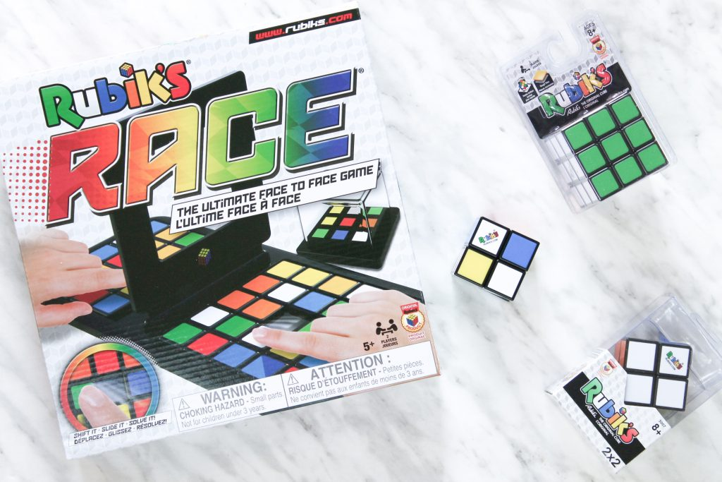 Flatlay of Rubik's Cubes & Rubik's Race Board Game