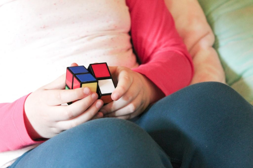 Child's Hands Solving Rubik's Cube