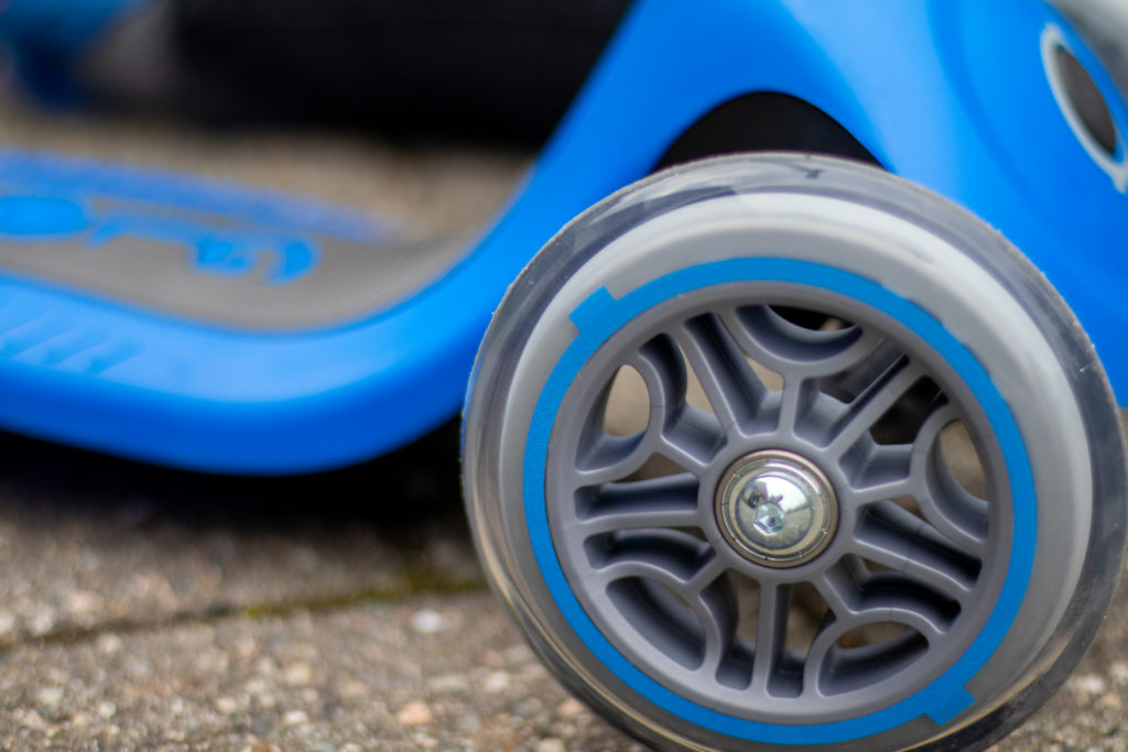 Up Close of Blue and Grey Globber Scooter Wheels