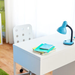 White desk and chair with blue lamp for studies