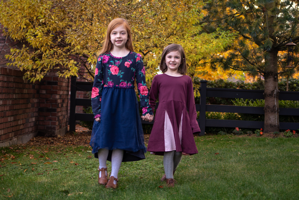 Sisters wearing floral navy dress and maroon skater dress from pk beans
